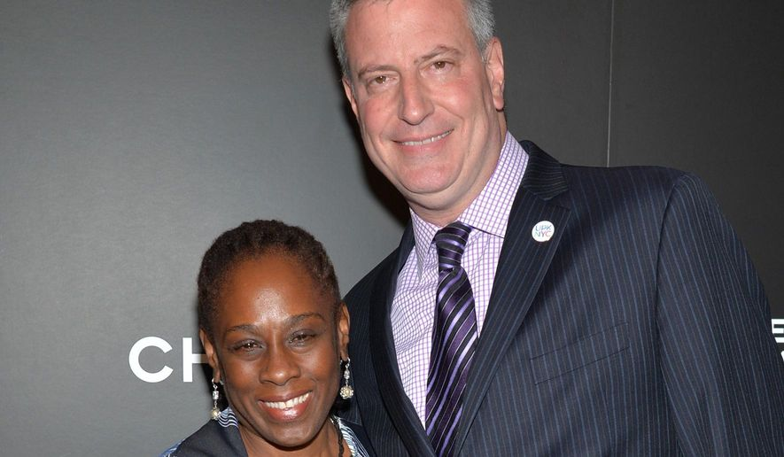 """FILE- In this April 26, 2104 file photo, Chirlane McCray, left, and New York City Mayor Bill de Blasio arrive at the premiere of """"Begin Again"""" at the Tribeca Film Festival in New York. Often described by the mayor as his closest advisor, a recent poll shows that some New Yorkers feel that she should have a more limited role. During the royal visit on the week of Dec. 7, 2014, McCray's international profile will rise as she will chaperone Kate Middleton, the Duchess of Cambridge, during her and Prince William's royal visit.  (Photo by Evan Agostini/Invision/AP/File)"""