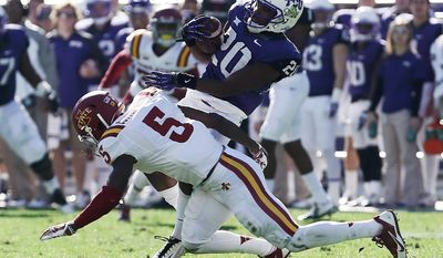 Iowa State defensive back Kamari Cotton-Moya (5) tackles TCU wide receiver Deante' Gray (20) during the first half of an NCAA college football game at Amon G. Carter Stadium, Saturday, Dec. 6, 2014, in Fort Worth, Texas. (AP Photo/Brandon Wade)