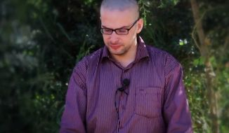 This image made from militant video posted online by militants on Thursday, Dec. 4, 2014, which has been verified and is consistent with other AP reporting, shows Luke Somers, an American photojournalist born in Britain held hostage by al-Qaida's affiliate in Yemen.  Somers has been killed in a failed rescue attempt, his sister said Saturday, Dec. 6, 2014. Lucy Somers told The Associated Press that she and her father learned of her 33-year-old brother Luke Somers' death from FBI agents at 0500 GMT (12 a.m. EST) Saturday. (AP Photo/militant video)
