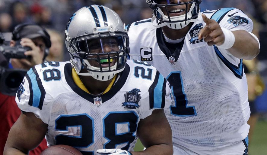 Carolina Panthers quarterback Cam Newton (1) celebrates with running back Jonathan Stewart (28) after Stewart's 69-yard touchdown carry in the second half of an NFL football game against the New Orleans Saints in New Orleans, Sunday, Dec. 7, 2014. (AP Photo/Bill Feig)