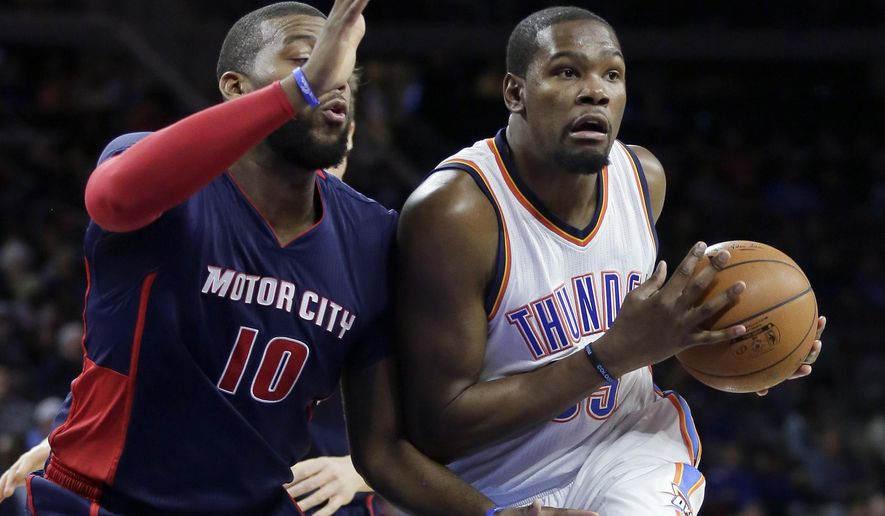 Oklahoma City Thunder's Kevin Durant, right, drives to the basket against Detroit Pistons' Greg Monroe (10) during the first half of an NBA basketball game Sunday, Dec. 7, 2014, in Detroit. (AP Photo/Duane Burleson)