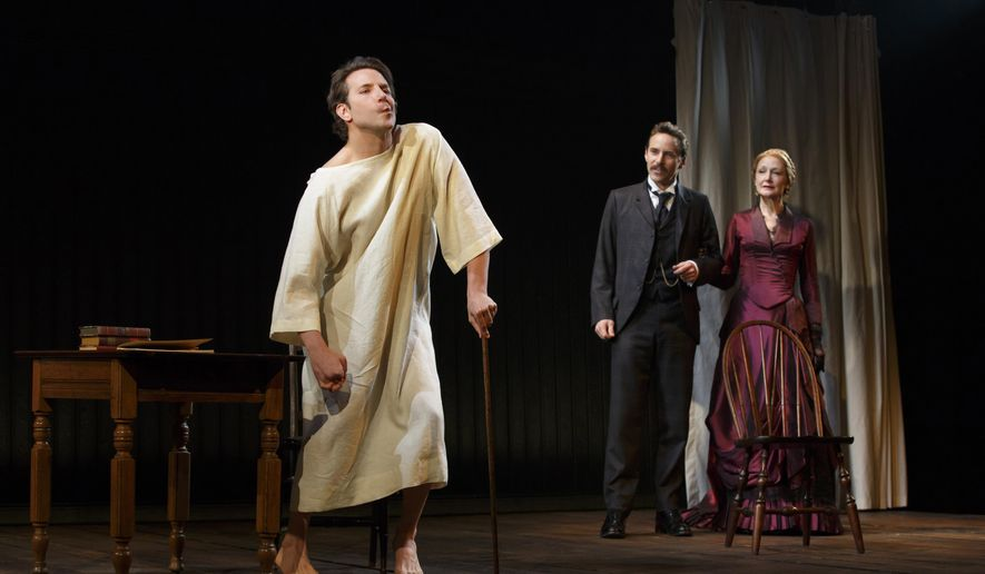 "This image released by Boneau/Bryan-Brown shows Bradley Cooper, from left, Alessandro Nivola, and Patricia Clarkson during a performance of ""The Elephant Man,"" at the Booth Theatre in New York. (AP Photo/Boneau/Bryan-Brown, Joan Marcus)"