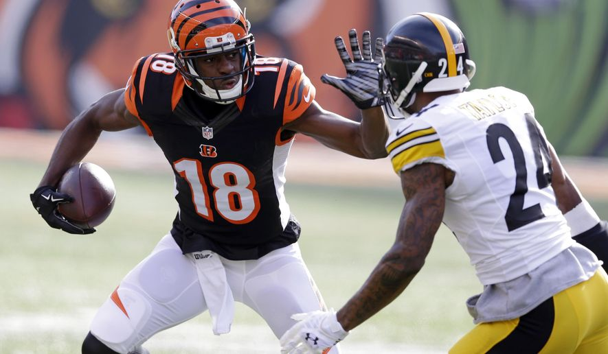 Cincinnati Bengals wide receiver A.J. Green (18) runs against Pittsburgh Steelers cornerback Ike Taylor (24) during the first half of an NFL football game Sunday, Dec. 7, 2014 in Cincinnati. (AP Photo/Michael Conroy)