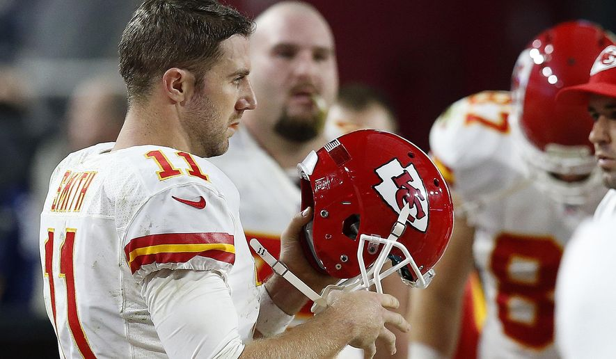 Kansas City Chiefs' Alex Smith puts his helmet back on to go back out onto the field during the second half of an NFL football game against the Arizona Cardinals, Sunday, Dec. 7, 2014, in Glendale, Ariz. The Cardinals defeated the Chiefs 17-14. (AP Photo/Ross D. Franklin)