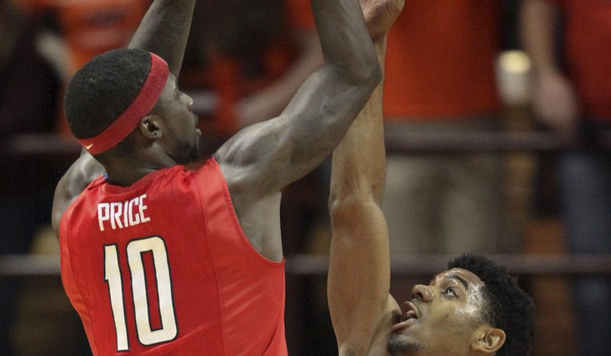 Radford's R.J. Price (10) shoots past the defense of Tech's Jalen Hudson (23) in the second half of the Virginia Tech - Radford University NCAA basketball game in Blacksburg Va., Sunday, Dec.7, 2014. Price had a team high 25 points in the game and Radford University won 68-66. (AP Photo / The Roanoke Times, Matt Gentry)LOCAL STATIONS OUT; LOCAL INTERNET OUT; LOCAL PRINT OUT (SALEM TIMES REGISTER; FINCASTLE HERALD; CHRISTIANSBURG NEWS MESSENGER; RADFORD NEWS JOURNAL; ROANOKE STAR SENTINEL