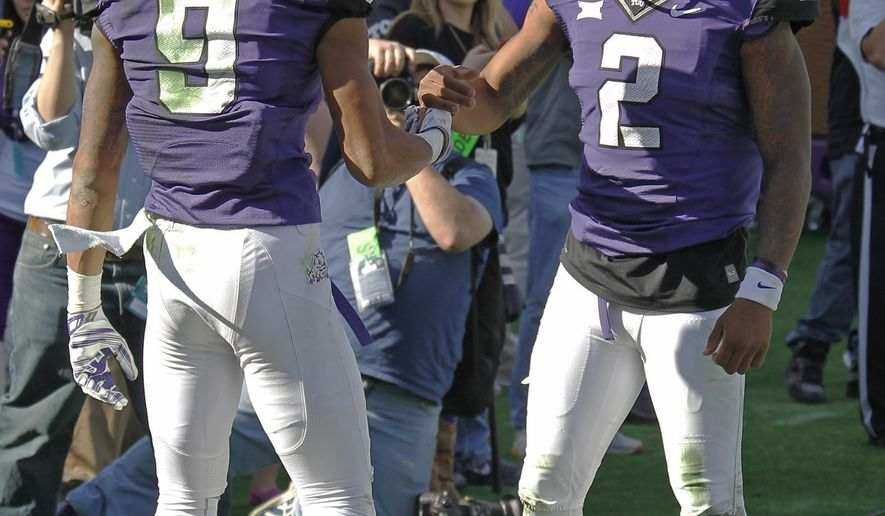 TCU wide receiver Josh Doctson (9) gets a hand shake from quarterback Trevone Boykin (2) after Doctson caught a touchdown pass during the third quarter of an NCAA college football game against Iowa State at Amon G. Carter Stadium, Saturday, Dec. 6, 2014, in Fort Worth, Texas. (AP Photo/The Fort Worth Star-Telegram, Paul Moseley)  MAGS OUT; (FORT WORTH WEEKLY, 360 WEST); INTERNET OUT