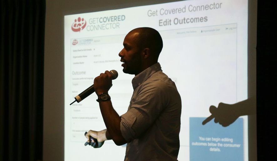 In this Friday, Nov. 7, 2014 photo, Raymond Paultre, the organizing director of Enroll America in Florida, explains how to use the Get Covered Connector tool during a training session for navigators in Fort Lauderdale, Fla. Navigators will be signing up people for insurance coverage when the second enrollment period for the Affordable Care Act begins Nov. 15. (AP Photo/Lynne Sladky)