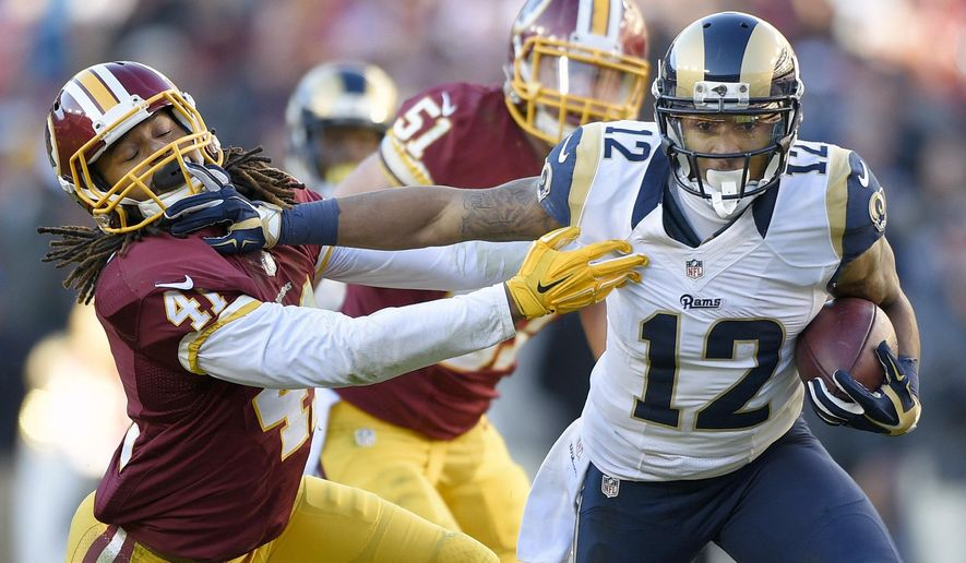 St. Louis Rams wide receiver Stedman Bailey (12) pushes back Washington Redskins strong safety Phillip Thomas (41) during the second half of an NFL football game in Landover, Md., Sunday, Dec. 7, 2014. (AP Photo/Nick Wass)