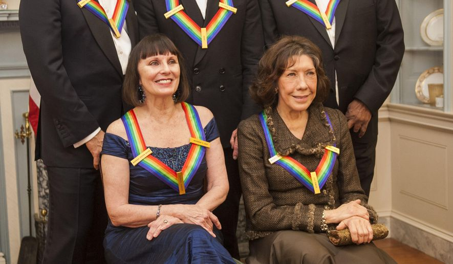 From left, 2014 Kennedy Center Honorees Tom Hanks, Patricia McBride, Sting, Lily Tomlin and Al Green pose for a photo following the State Department Dinner for the Kennedy Center Honors on Saturday, Dec. 6, 2014 at the State Department in Washington. (AP Photo/Kevin Wolf)