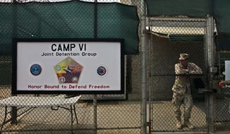 A soldier stands guard at the front gate entrance to Guantanamo's Camp 6 maximum-security detention facility at Guantanamo Bay U.S. Naval Base in Cuba on May 12, 2009. (Associated Press) **FILE**