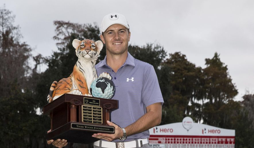 Jordan Spieth holds the championship trophy after winning the Hero World Challenge golf tournament on Sunday, Dec. 7, 2014, in Windermere, Fla. (AP Photo/Willie J. Allen Jr.)