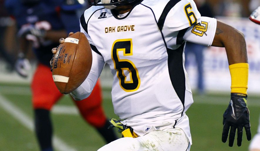 Oak Grove's quarterback Cameron Myers (6) rushes out of the pocket to pick up a first down in the first half of the Mississippi 6A Championship high school football game against South Panola on Sunday, Dec. 7, 2014, in Starkville, Miss. (AP Photo/Rogelio V. Solis)