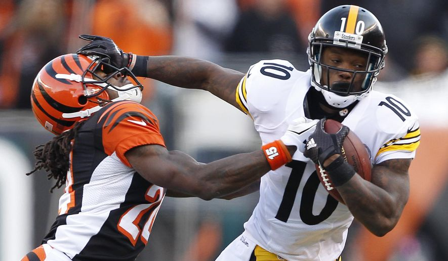 Pittsburgh Steelers wide receiver Martavis Bryant (10) runs past Cincinnati Bengals cornerback Adam Jones (24) during the second half of an NFL football game Sunday, Dec. 7, 2014, in Cincinnati. (AP Photo/Frank Victores)