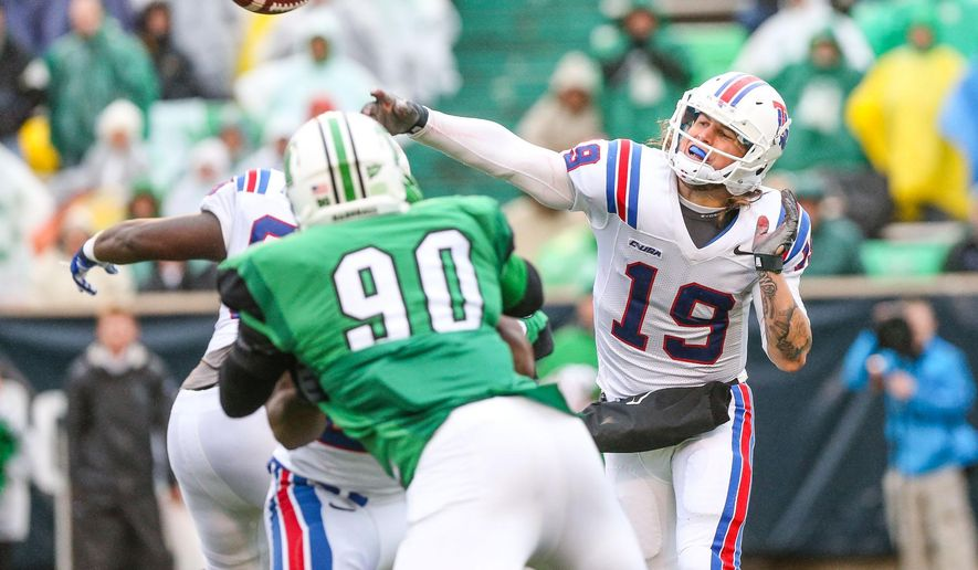 Louisiana Tech quarterback Cody Soko (19) makes a pass in the NCAA college football, C-USA Championship game on Saturday, Dec. 6, 2014, at Joan C. Edwards Stadium in Huntington, W.Va. Marshall would win the C-USA title by a score of 26-23. (AP Photo/The Herald-Dispatch, Sholten Singer)