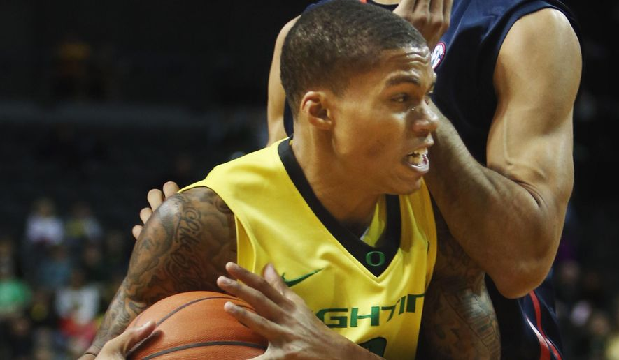 Oregon's Joseph Young is stopped on a drive to the basket by Mississippi's Anthony Perez during the first half of the non-conference matchup at Matthew Knight Areana in Eugene, Ore., on Sunday, Dec. 7, 2014. Mississippi won the contest  79-73. (AP Photo/The Register-Guard, Andy Nelson)