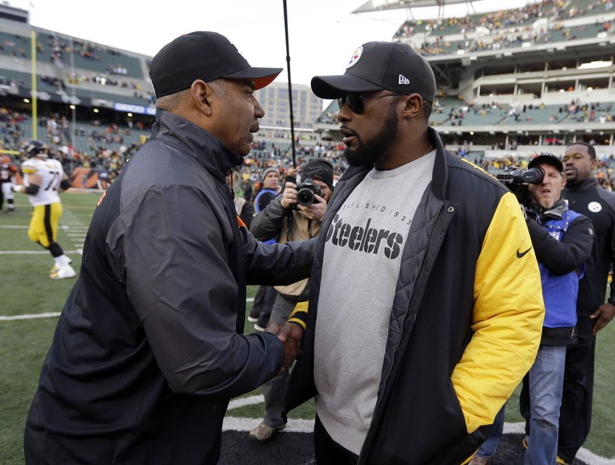 Pittsburgh Steelers head coach Mike Tomlin, right, is congratulated by Cincinnati Bengals head coach Marvin Lewis following an NFL football game Sunday, Dec. 7, 2014 in Cincinnati. Pittsburgh won the game 42-21. (AP Photo/Michael Conroy)