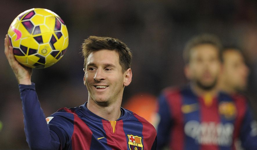 FC Barcelona's Lionel Messi, from Argentina, holds the ball after scoring a hat-trick in the Spanish La Liga soccer match between FC Barcelona and Espanyol at the Camp Nou stadium in Barcelona, Spain, Sunday, Dec. 7, 2014. (AP Photo/Manu Fernandez)