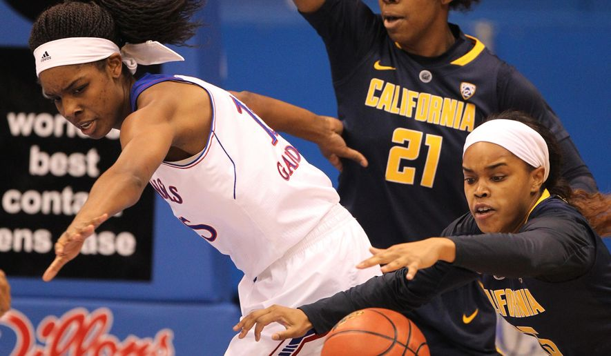 Kansas' Chelsea Gardner, left, loses control of the ball against California's Reshanda Gray (21) and Brittany Boyd (15) in the first half during an NCAA college basketball game Sunday, Dec. 7, 2014, in Lawrence, Kan. (AP Photo/Ed Zurga)