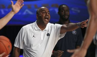 **FILE** Georgetown head coach John Thompson III directs his players during their third place game against Butler in the Battle 4 Atlantis basketball tournament in Paradise Island, Bahamas, Friday Nov. 28, 2014. (AP Photo/Tim Aylen)