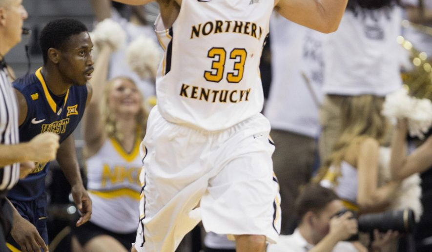 Northern Kentucky's Anthony Monaco celebrates hitting a 3-point basket against West Virginia late in the first half of an NCAA college basketball game in Highland Heights, Ky., Sunday, Dec. 7, 2014. (AP Photo/David Stephenson)