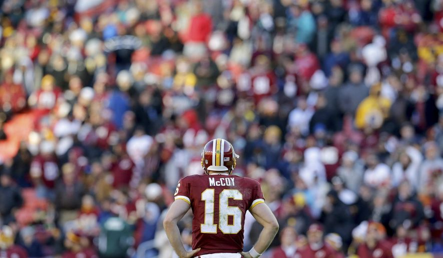 Washington Redskins quarterback Colt McCoy (16) looks back at the bench in the closing minutes of the Redskins 24-0 loss to the St. Louis Rams in an NFL football game in Landover, Md., Sunday, Dec. 7, 2014. (AP Photo/Patrick Semansky)