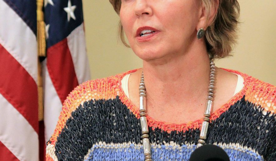 FILE - In this Jan. 22, 2013 file photo, Bernalillo County District Attorney Kari Brandenburg answers questions during a news conference in Albuquerque, N.M. The Albuquerque Journal on Sunday, Dec. 7, 2014 reported that Brandenburg is facing accusations that she offered to reimburse burglary victims to keep her son from being implicated as a suspect. (AP Photo/Susan Montoya Bryan, File)