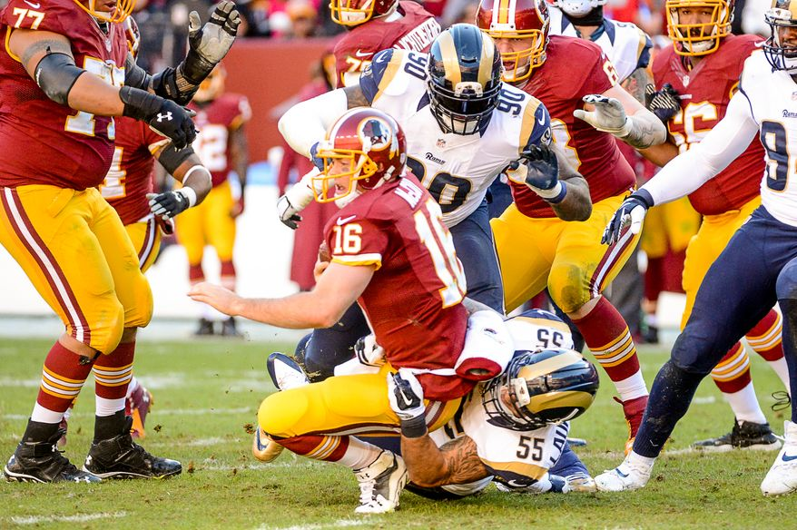St. Louis Rams middle linebacker James Laurinaitis (55) sacks Washington Redskins quarterback Colt McCoy (16) in the second quarter as the Washington Redskins play the St. Louis Rams in NFL football at FedExField, Landover, Md., Sunday, December 7, 2014. (Andrew Harnik/The Washington Times)