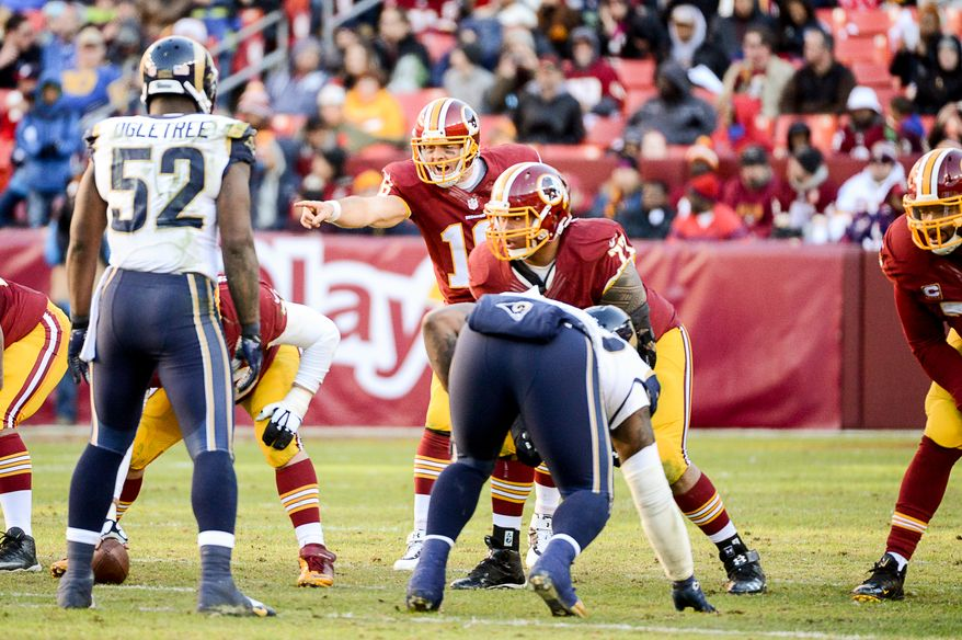 Washington Redskins quarterback Colt McCoy (16) before snapping the ball in the third quarter as the Washington Redskins play the St. Louis Rams in NFL football at FedExField, Landover, Md., Sunday, December 7, 2014. (Andrew Harnik/The Washington Times)