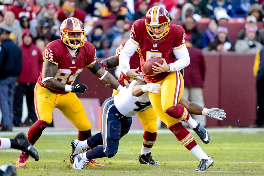 Washington Redskins punter Tress Way (5) can't get a first down as he is tackled on a trick punt play on fourth down in the third quarter as the Washington Redskins play the St. Louis Rams in NFL football at FedExField, Landover, Md., Sunday, December 7, 2014. (Andrew Harnik/The Washington Times)