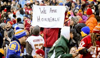 "A Washington Redskins holds up a sign that reads ""We Are Horrible"" as St. Louis Rams scores a touchdown in the third quarter as the Washington Redskins play the St. Louis Rams in NFL football at FedExField, Landover, Md., Sunday, December 7, 2014. (Andrew Harnik/The Washington Times)"