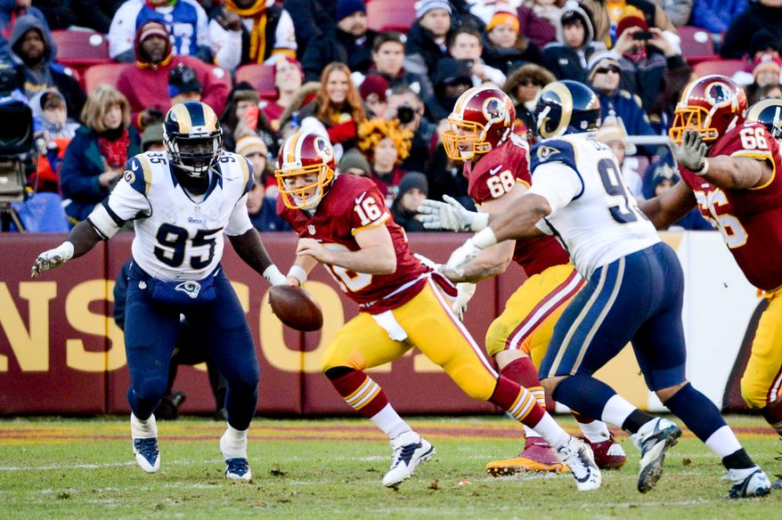 Washington Redskins quarterback Colt McCoy (16) scrambles in the fourth quarter as the Washington Redskins play the St. Louis Rams in NFL football at FedExField, Landover, Md., Sunday, December 7, 2014. (Andrew Harnik/The Washington Times)