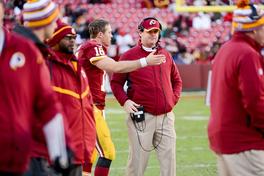 Washington Redskins quarterback Colt McCoy (16) talks with Washington Redskins head coach Jay Gruden on the sideline late in the fourth quarter as the Washington Redskins play the St. Louis Rams in NFL football at FedExField, Landover, Md., Sunday, December 7, 2014. (Andrew Harnik/The Washington Times)