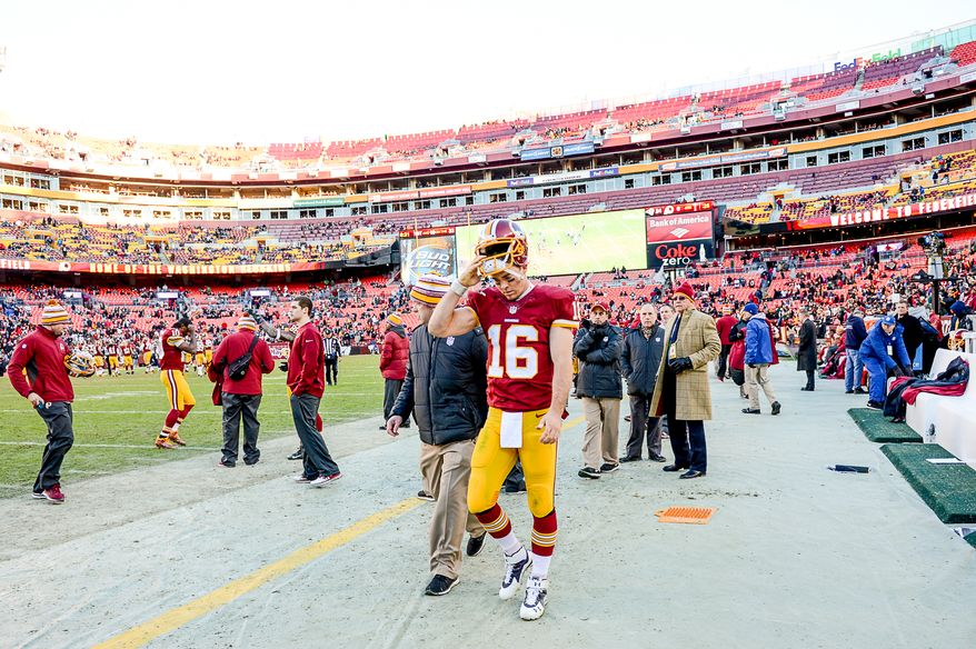 Washington Redskins quarterback Colt McCoy (16) leaves the field just before the Washington Redskins lose to the St. Louis Rams 24-0 in NFL football at FedExField, Landover, Md., Sunday, December 7, 2014. (Andrew Harnik/The Washington Times)