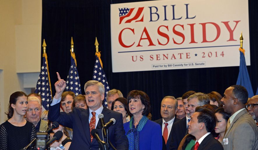 "Surrounded by family and friends, Republican Louisiana U.S. Sen.-elect Bill Cassidy thanks supporters for their help during his election watch party in Baton Rouge, La., Saturday, Dec. 6, 2014. Cassidy denied Democratic Sen. Mary Landrieu of Louisiana a fourth term, calling his Senate victory ""the exclamation point"" on midterm elections that put Republicans in charge on Capitol Hill for President Barack Obama's last two years in office. (AP Photo/Bill Feig)"