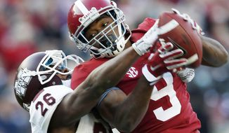 FILE - In this Nov. 15, 2014, file photo, Alabama wide receiver Amari Cooper (9) catches a 50-yard pass against Mississippi State defensive back Kendrick Market (26) in the first half of an NCAA college football game in Tuscaloosa, Ala. Oregon quarterback Marcus Mariota, Alabama receiver Cooper and record-breaking Wisconsin running back Melvin Gordon are the finalists for the Heisman Trophy announced Monday, Dec. 8. (AP Photo/Butch Dill, File)