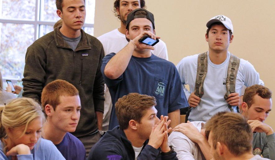 TCU students react to the announcement that the Horned Frogs were not selected for the College Football Playoff, as they watch the proceedings on television at the Brown-Lupton University Student Union cafeteria on campus in Fort Worth, Texas on Sunday, Dec. 7, 2014.    (AP Photo/The Dallas Morning News, Louis DeLuca)  MANDATORY CREDIT; MAGS OUT; TV OUT; INTERNET USE BY AP MEMBERS ONLY; NO SALES