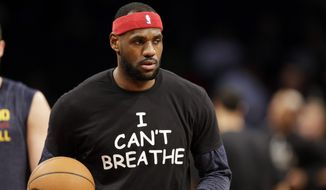 """Cleveland Cavaliers' LeBron James warms up before an NBA basketball game against the Brooklyn Nets at the Barclays Center, Monday, Dec. 8, 2014, in New York. Professional athletes have worn """"I Can't Breathe"""" messages in protest of a grand jury ruling not to indict an officer in the death of a New York man. (AP Photo/Frank Franklin II)"""