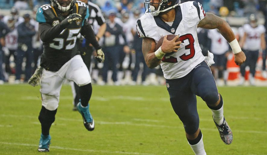 Houston Texans running back Arian Foster (23) runs past Jacksonville Jaguars outside linebacker Geno Hayes (55) for a 1-yard touchdown during the second half of an NFL football game in Jacksonville, Fla., Sunday, Dec. 7, 2014. (AP Photo/Stephen B. Morton)
