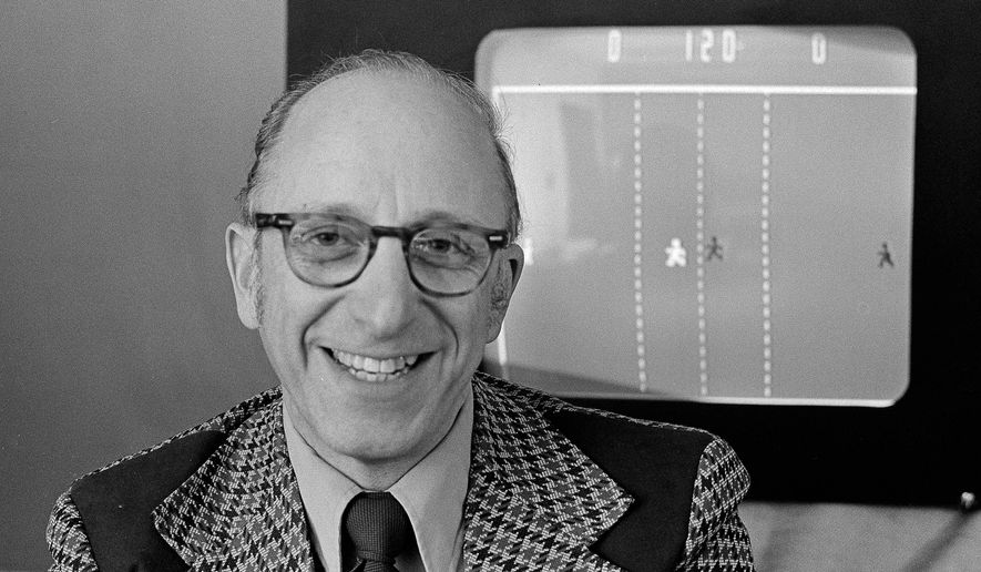 "FILE - In this Feb. 3, 1977, file photo, Ralph Baer, an engineer for Sanders Associates, Inc., of Nashua, N.H., watches his TV hockey game in this double exposure, in Nashua. Baer, a video game pioneer who created an electronic table tennis game, the precursor to ""Pong,"" and led the team that developed the Magnavox Odyssey, the first home video game console, died Saturday, Dec. 6, 2014. He was 92. (AP Photo/File)"