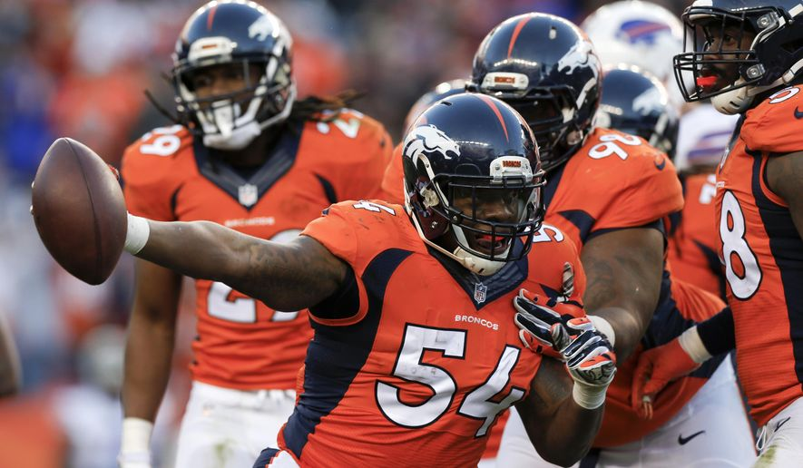 Denver Broncos outside linebacker Brandon Marshall celebrates an interception against the Buffalo Bills during the second half in an NFL football game Sunday, Dec. 7, 2014, in Denver. (AP Photo/David Zalubowski)