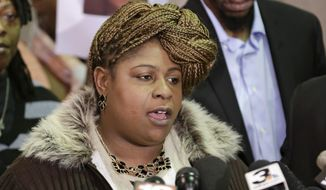 Samaria Rice, the mother of Tamir Rice, a 12-year-old boy fatally shot by a Cleveland police officer, speaks during a news conference Monday, Dec. 8, 2014, in Cleveland. Surveillance video released by police shows Tamir Rice being shot within 2 seconds of a patrol car stopping within a few feet of him at a park on Nov. 22. Leonard Warner, right, Tamir's father, listens. (AP Photo/Tony Dejak)