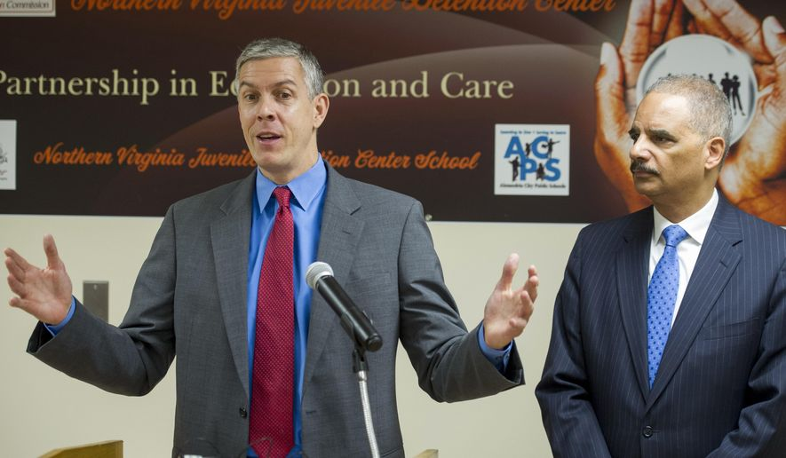 Attorney General Eric Holder listens at right as Education Secretary Arne Duncan speaks with reporters after they toured the Northern Virginia Juvenile Detention Center  in Alexandria, Va., Monday, Dec. 8, 2014. Holder and Duncan used the event to announce guidelines aimed at providing quality educational services for youth in correctional facilities as part of President Barack Obama's My Brother's Keeper initiative. (AP Photo/Cliff Owen)