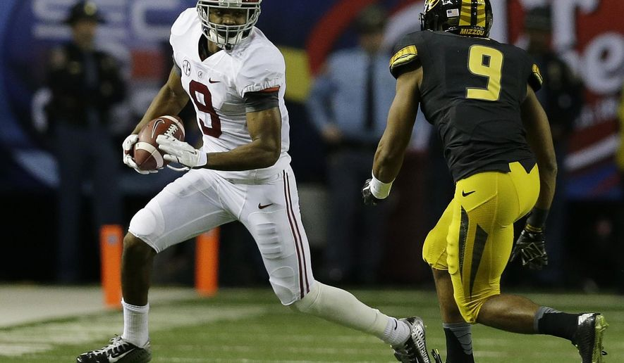 Alabama wide receiver Amari Cooper (9) runs toward Missouri safety Braylon Webb (9) during the first half of the Southeastern Conference championship NCAA college football game, Saturday, Dec. 6, 2014, in Atlanta. (AP Photo/Jamie Martin)