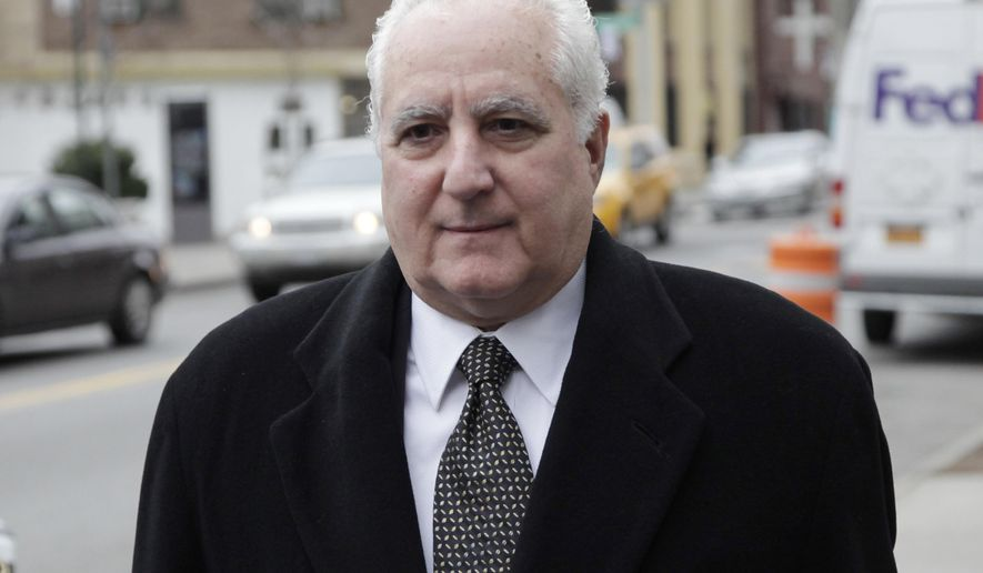 Daniel Bonventre, former director of operations for imprisoned financier Bernard Madoff, arrives at federal court for a sentencing hearing, Monday, Dec. 8, 2014 in New York. He's the first of five Madoff ex-employees to learn their fate in the coming days after a jury convicted them earlier this year of charges related to the multi-decade, multi-billion dollar fraud. (AP Photo/Mark Lennihan)