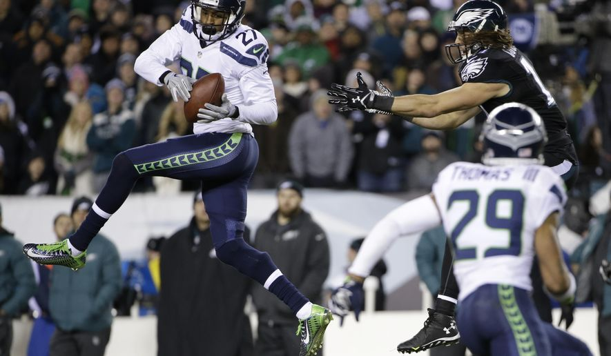 Seattle Seahawks' Tharold Simon (27) intercepts a pass intended for Philadelphia Eagles' Riley Cooper (14) during the second half of an NFL football game, Sunday, Dec. 7, 2014, in Philadelphia. (AP Photo/Matt Rourke)