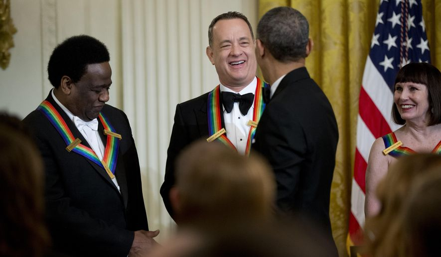 President Barack Obama congratulates 2014 Kennedy Center Honors Honorees, singer Al Green, from left,  actor and filmmaker Tom Hanks,and  ballerina Patricia McBride, during a reception in their honor in the East Room of the White House in Washington, Sunday, Dec. 7, 2014.     (AP Photo/Manuel Balce Ceneta)