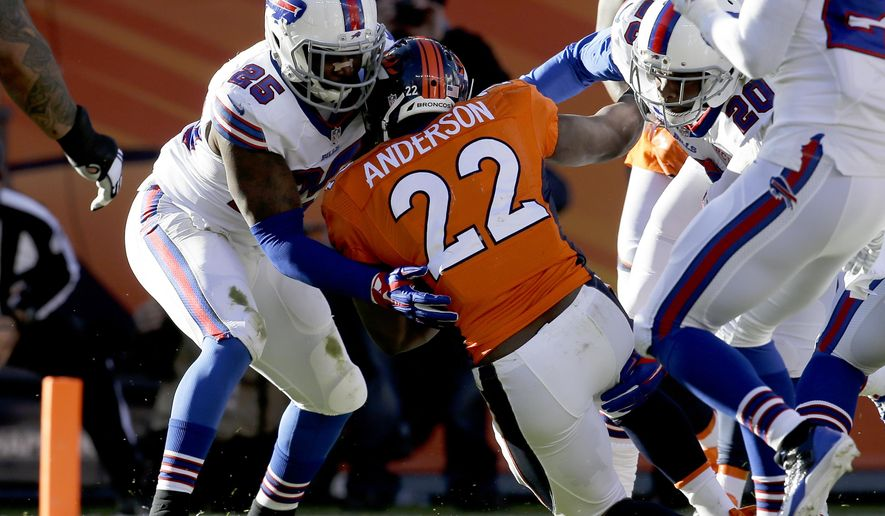 Denver Broncos running back C.J. Anderson (22) scores past Buffalo Bills strong safety Da'Norris Searcy (25) during the first half in an NFL football game Sunday, Dec. 7, 2014, in Denver. (AP Photo/Joe Mahoney)