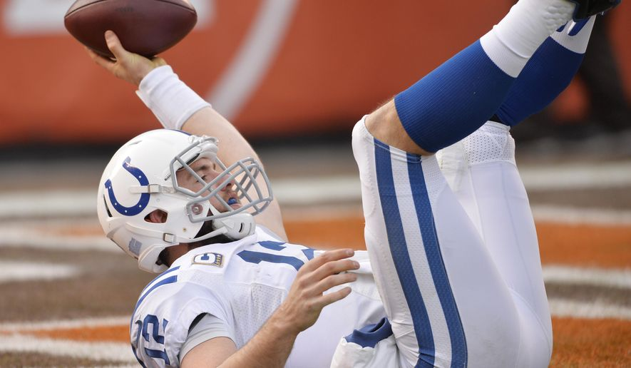Indianapolis Colts quarterback Andrew Luck celebrates in the end zone after an 11-yard touchdown run against the Cleveland Browns in the second quarter of an NFL football game Sunday, Dec. 7, 2014, in Cleveland. (AP Photo/David Richard)