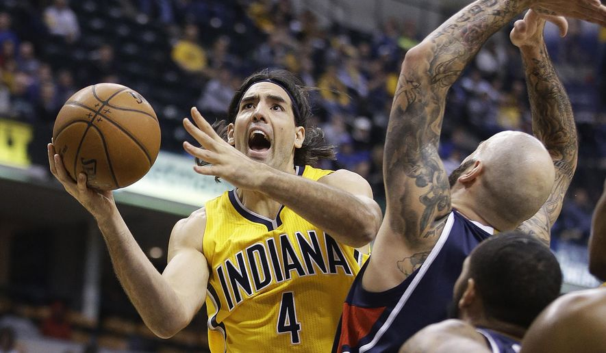 Indiana Pacers' Luis Scola (4) puts up a shot against Atlanta Hawks' Pero Antic (6) during the first half of an NBA basketball game Monday, Dec. 8, 2014, in Indianapolis. (AP Photo/Darron Cummings)
