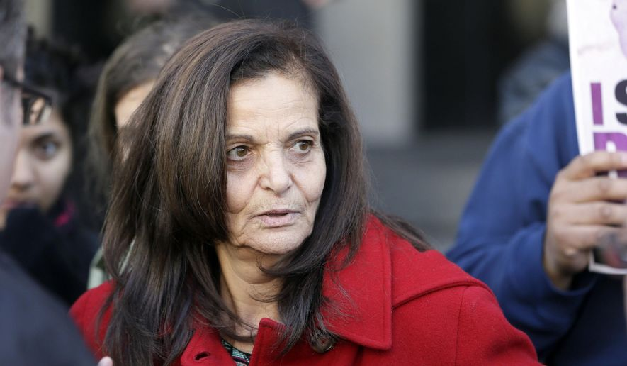 FILE- In this Monday, Nov. 10, 2014, file photo, Rasmieh Yousef Odeh, 67, of Chicago is interviewed outside federal court in Detroit, after the Palestinian immigrant was found guilty of immigration fraud for failing to disclose her conviction and imprisonment in a Jerusalem supermarket bombing that killed two people. On Monday, Dec. 8, 2014, U.S. District Judge Gershwin Drain reversed his earlier decision that Odeh remain jailed until her sentencing in March. Drain said he no longer believes she will flee and said she can leave by posting a $50,000 bond. She was charged for not revealing an Israeli military court conviction for several bombings in 1969. She served 10 years before being released in a prisoner swap with the Popular Front for the Liberation of Palestine. (AP Photo/Carlos Osorio, File)